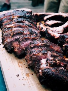 rack of ribs on wood dish