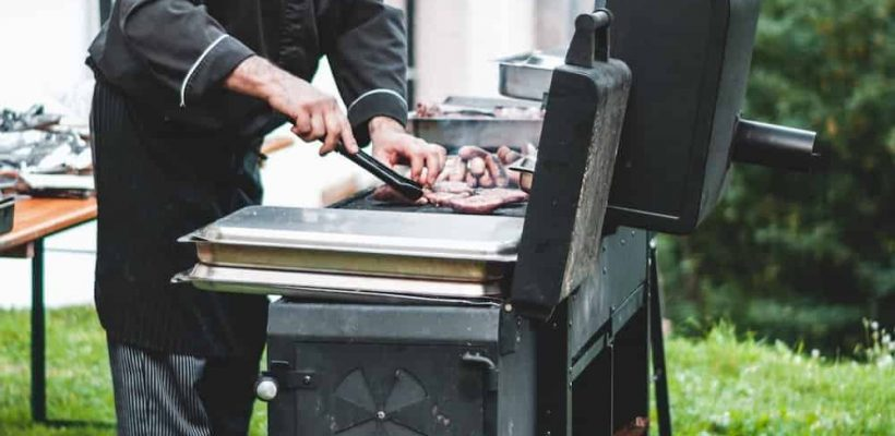 chef cooking in offset smoker
